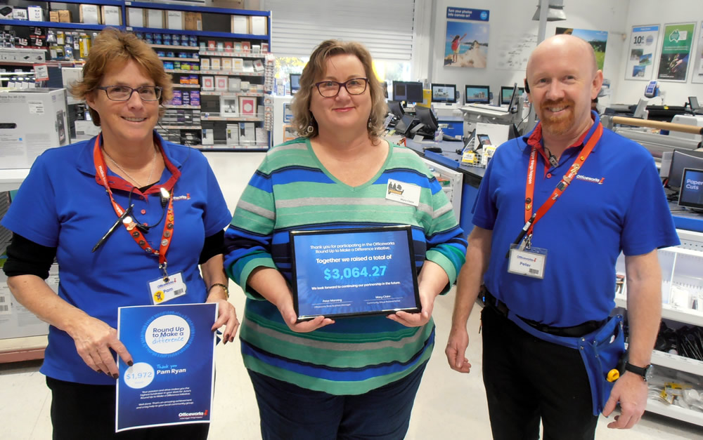 Mary-Claire from AToP accepting the donation from Peter, Officeworks Nowra's Business Manager, and Pam Ryan, the staff member responsible for almost 2/3 of the fundraising.