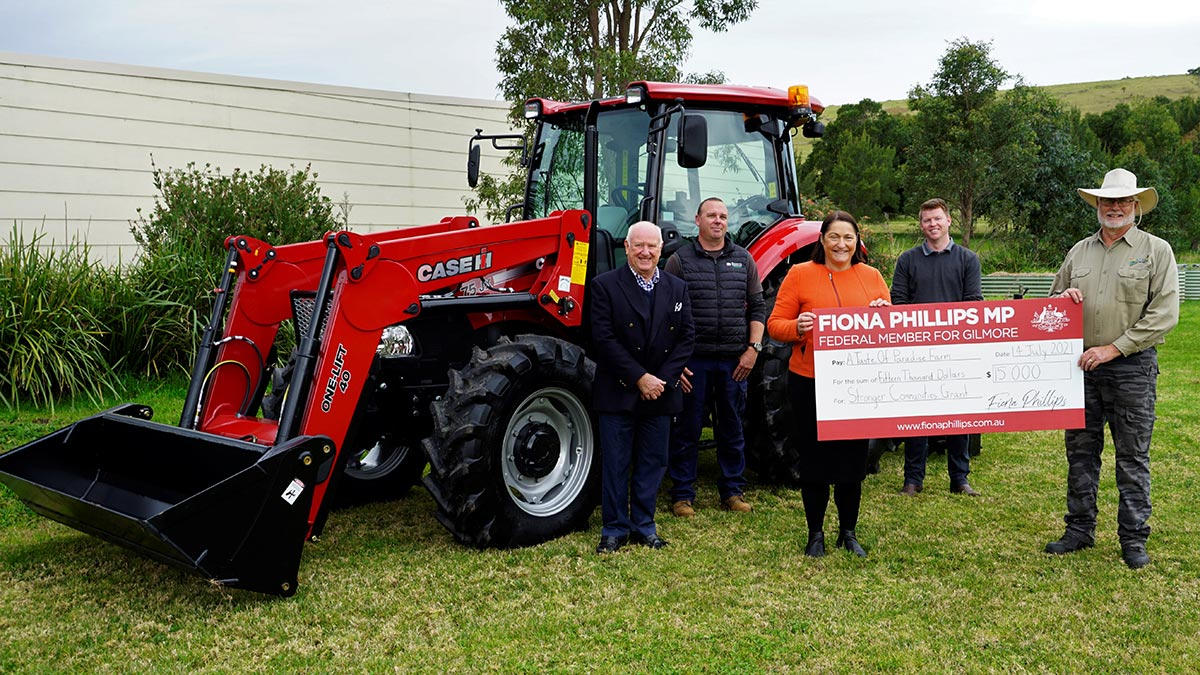 Member for Gilmore Fiona Phillips presents Tim with a grant of $15,000